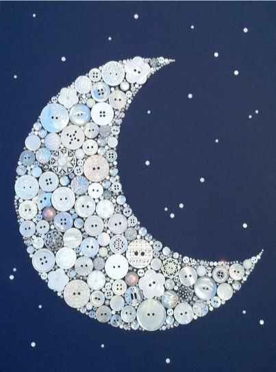 moon shape made of whitish buttons against a blue background