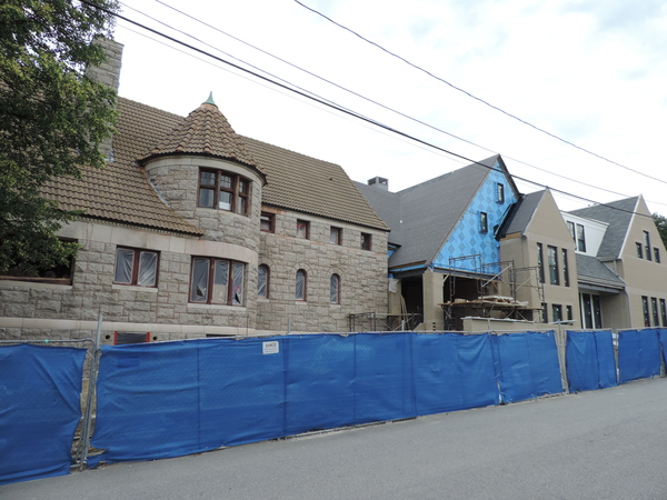 Image from Church Street of library under construction with blue fence in front